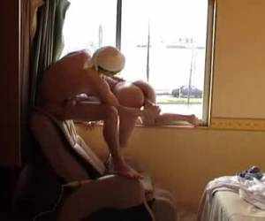 Wife getting fucked whiteh toy in front of the window