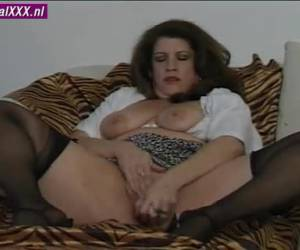 As her husband from home, she stops a dildo in her pussy and ass