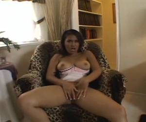 Sitting in the chair in sexy lingerie masturbate the Asian her wet pussy