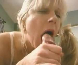 Horny milf gives his big cock a nice blowjob