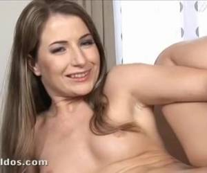 Slowly, she gives a striptease and masturbate whiteh a big dildo