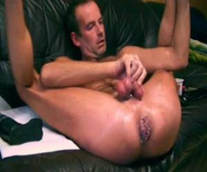 Tasty gay stops a giant anal dildo in his anus