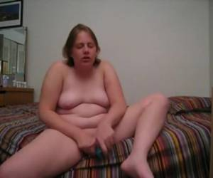 Chubby milf fucks her horny pussy whiteh a sex toy