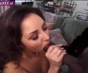 Her red lips stuck tightly to the thick black cock