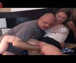 In the kitchen and fist fucks her man her bald wet pussy