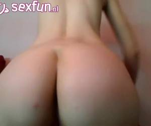 The dildo disappears deeply in her anus on webcam