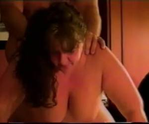 His immense wife gives him a blowjob and he gives her doggystyle