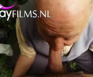 Sneak blowjob in the bushes