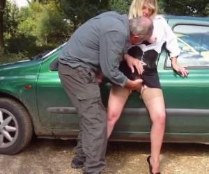 Horny mature slut lets himself against the car