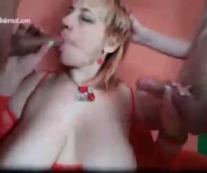 Mother licks two cocks