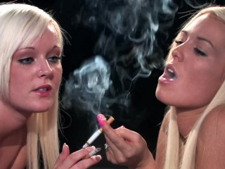 Blonde sisters smoking cigarettes