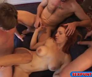 Red headed milf in a horny gangbang